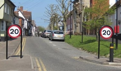 Prominent 20 mph signage, and traffic slowing pinch point, in Saffron Walden