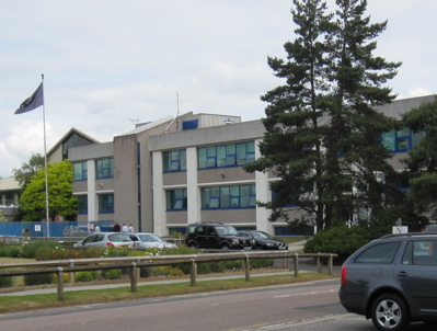 Cambridgeshire Police Headquarters, with the Chief Officers Shiny Cars Outside