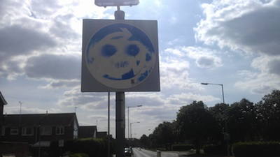 Graffitied Roundabout Sign