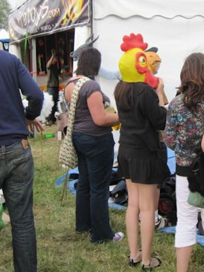 A girl with a chicken's head at the 2009 Strawberry Fair.
