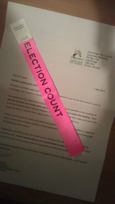 pink wristband saying Election Count on it
