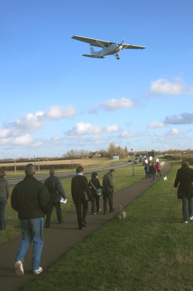 Planes Flew Over Those Walking Around Marshall Airport in Cambridge on the 15th of November to Express Support for the Company Continuing to Fly from the Airport.
