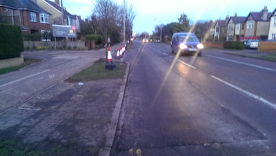 Photo of new junction with resurfacing as described.