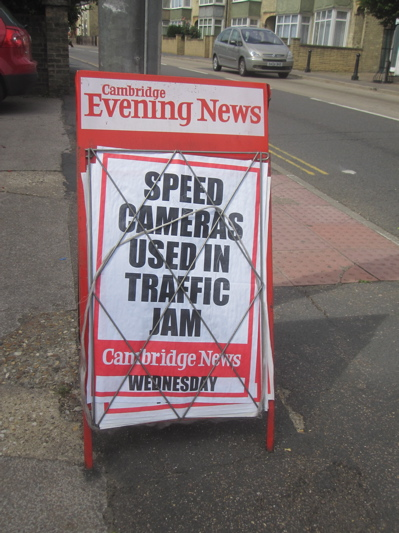 A Frame Containing Newspaper Headline on Speeding