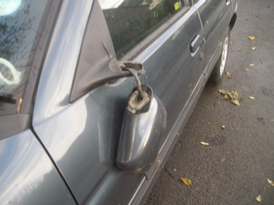 Images of broken wing mirrors and broken glass
