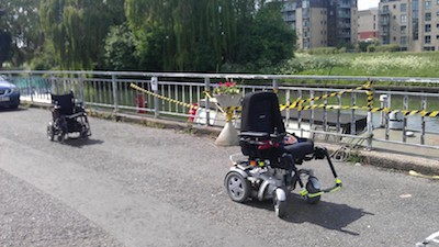 wheelchairs taking up road space to make car parking impossible