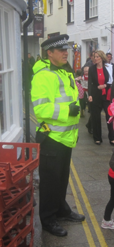 TASER armed officer on duty outside a pasty shop in Padstow, Cornwall.